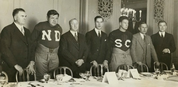 "The ND-USC series garnered national excitement. Here in 1927  George Herman ""Babe"" Ruth (wearing ND), Knute Rockne, sports agent Christy Walsh, Lou Gehrig (wearing SC), and USC coach Howard Jones."