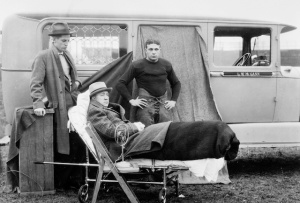 Knute Rockne in a wheelchair with player Frank Carrideo as phlebitis sidelined the ND coach.